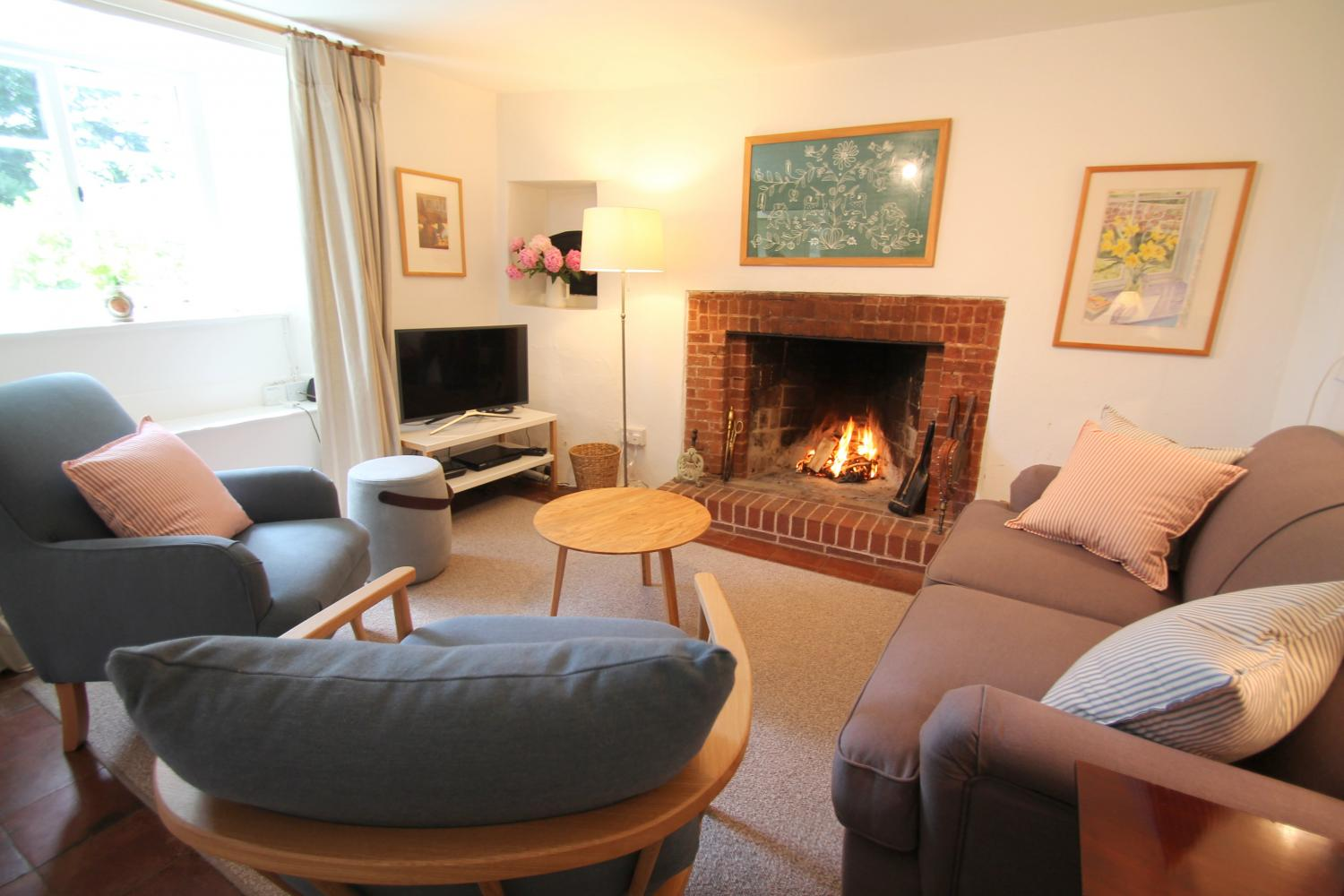 Ball Cottage sitting room with open fire