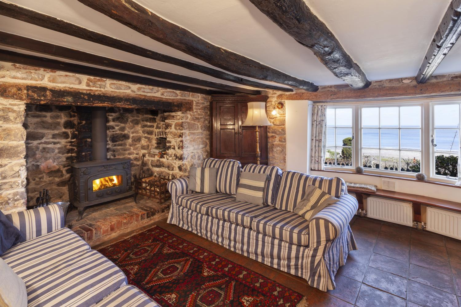 The Crows Nest sitting room with wood burner
