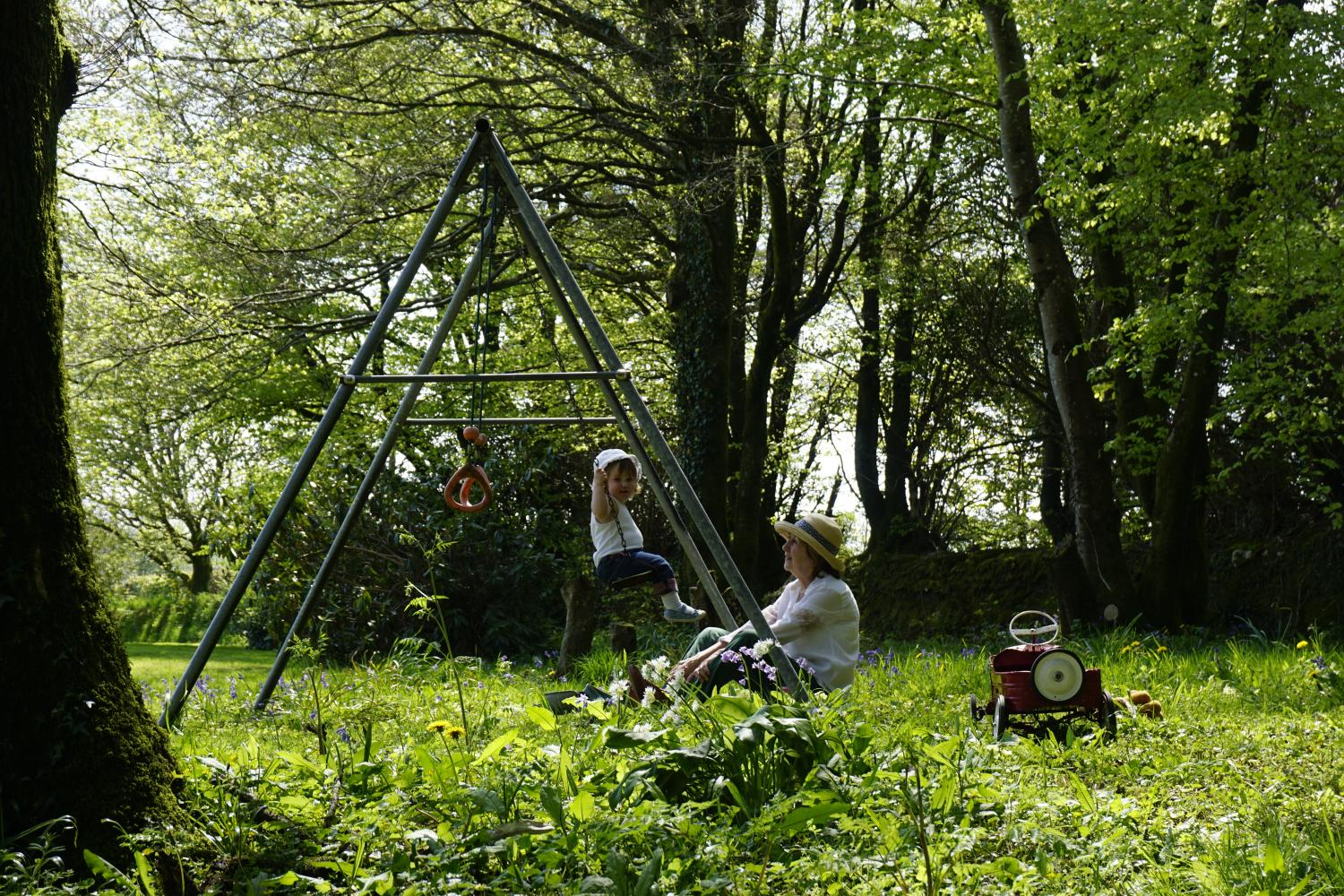 Swings and play in the garden woodland