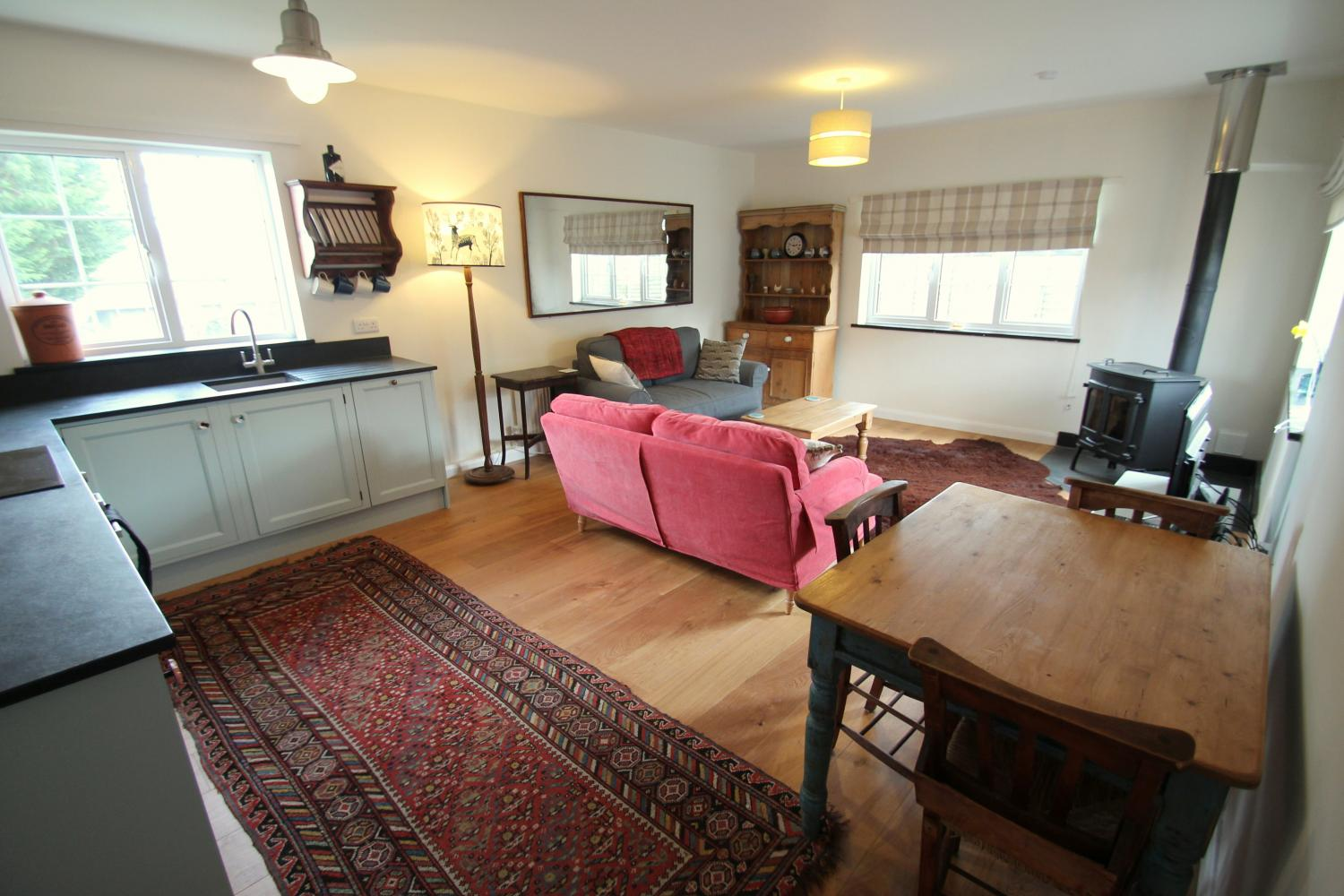 Sitting room / kitchen with large wood burner.