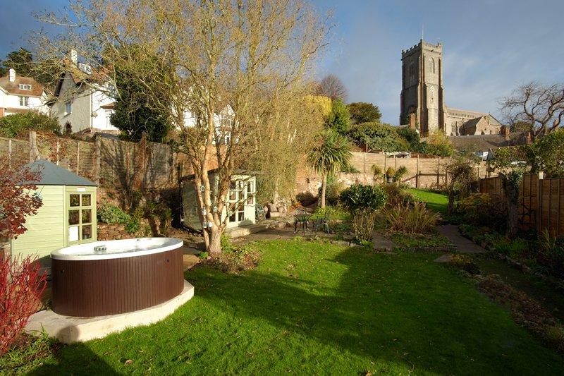 Enjoy views of the garden and church from the tub.