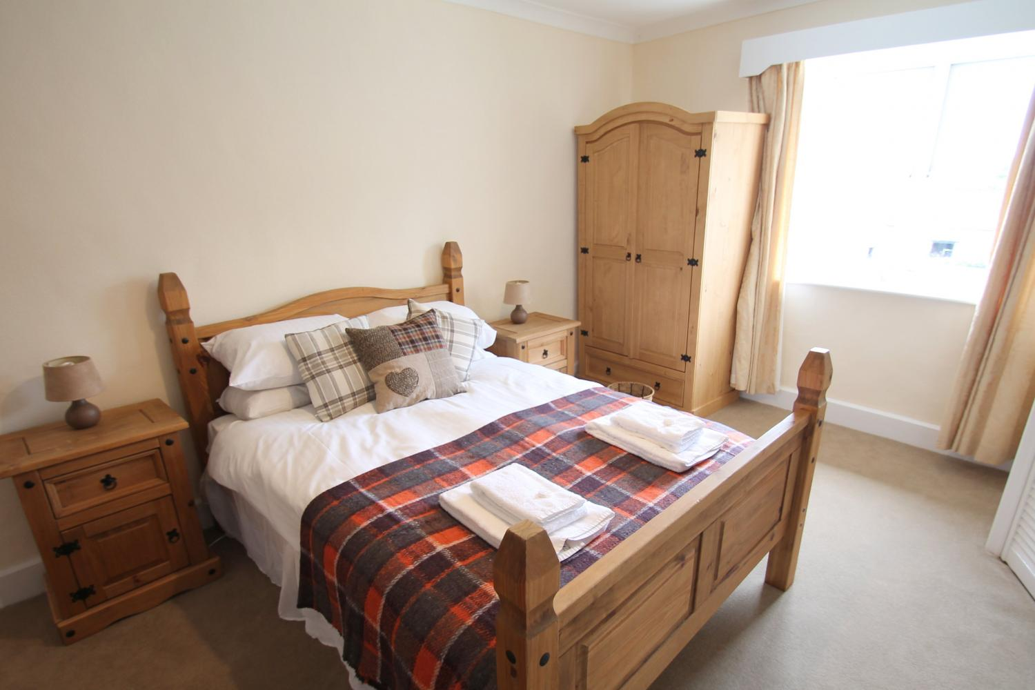 Master bedroom double bedded with ensuite shower and toilet rooms