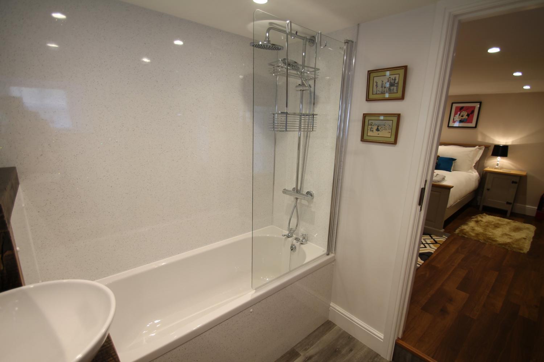 En-suite to Disney bedroom has a bath with shower over
