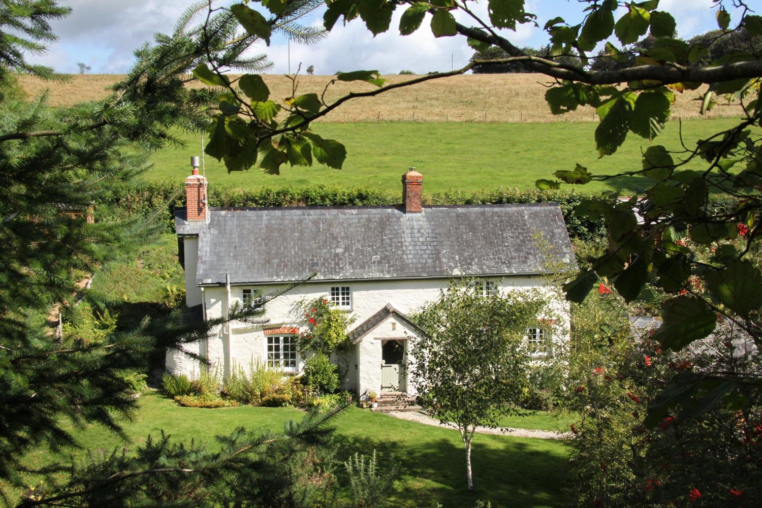 Cottage surrounded by beautiful countryside