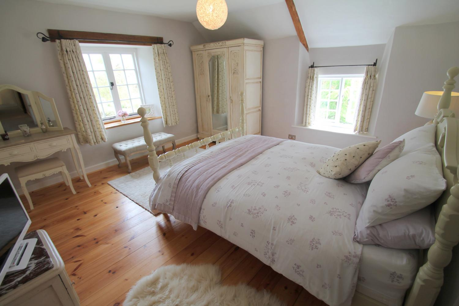 Large main bedroom with stunning views to the lake