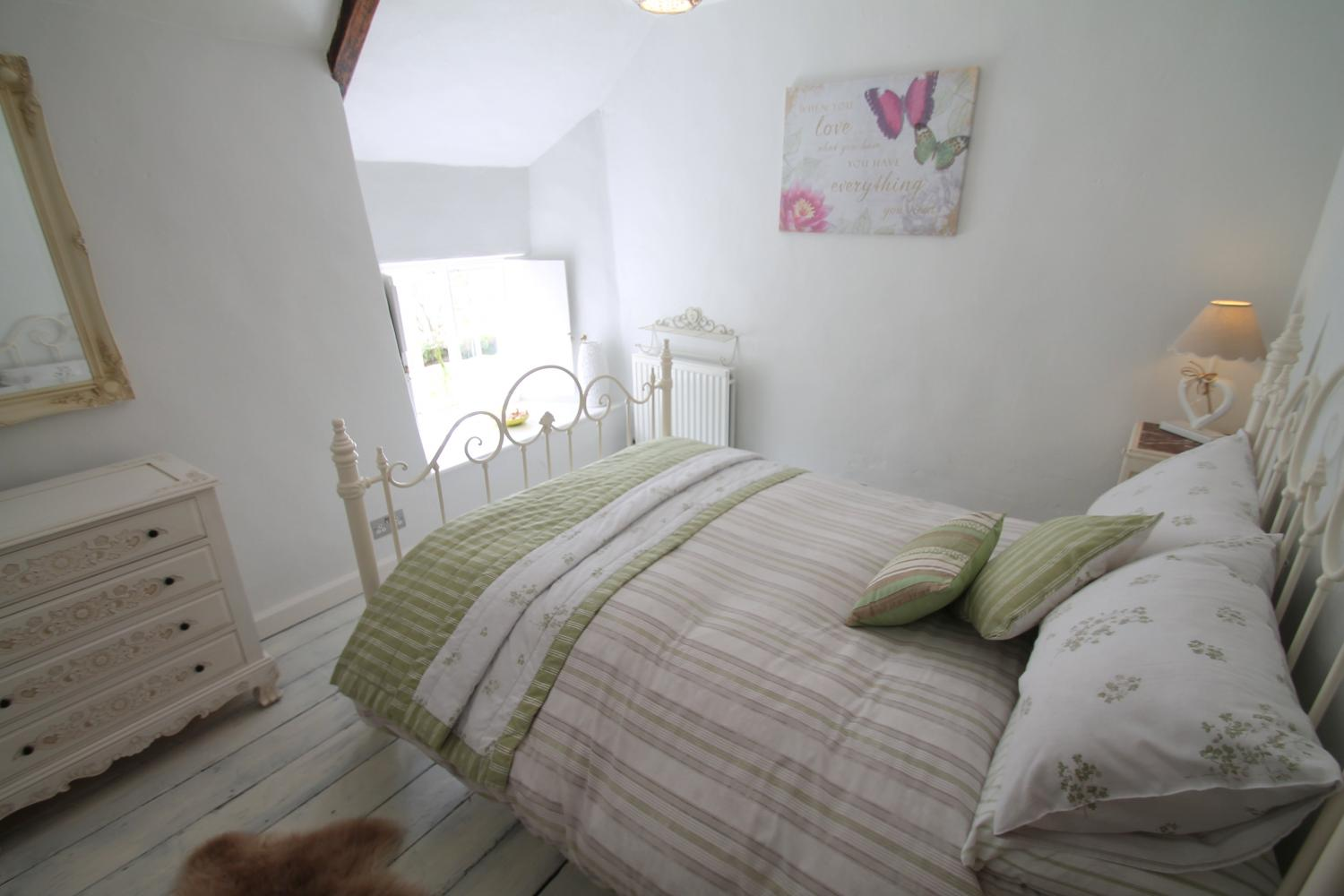 Double bedroom with gorgeous views to garden and stream