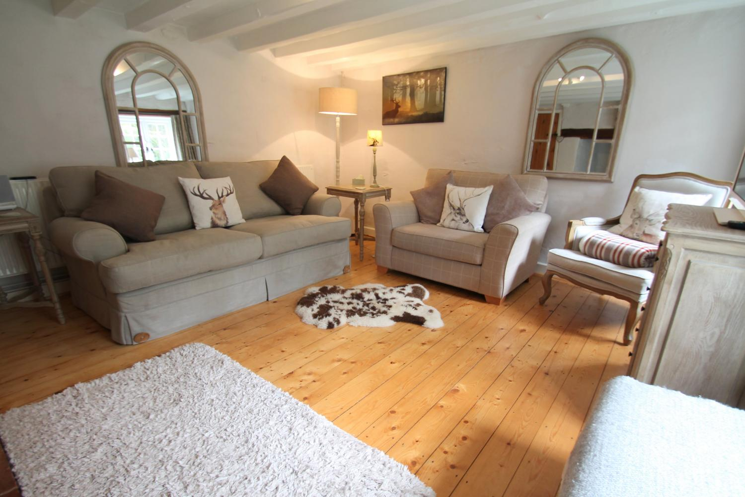 Comfortable seating in the cosy sitting room