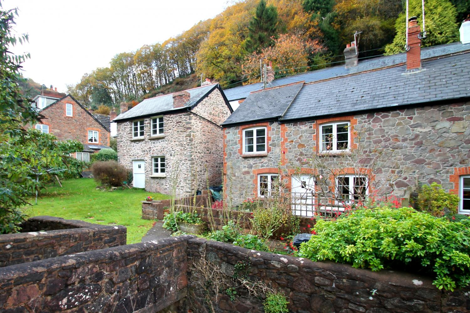 Magnolia Cottage is approached via its own bridge, over the Hawkcombe stream.