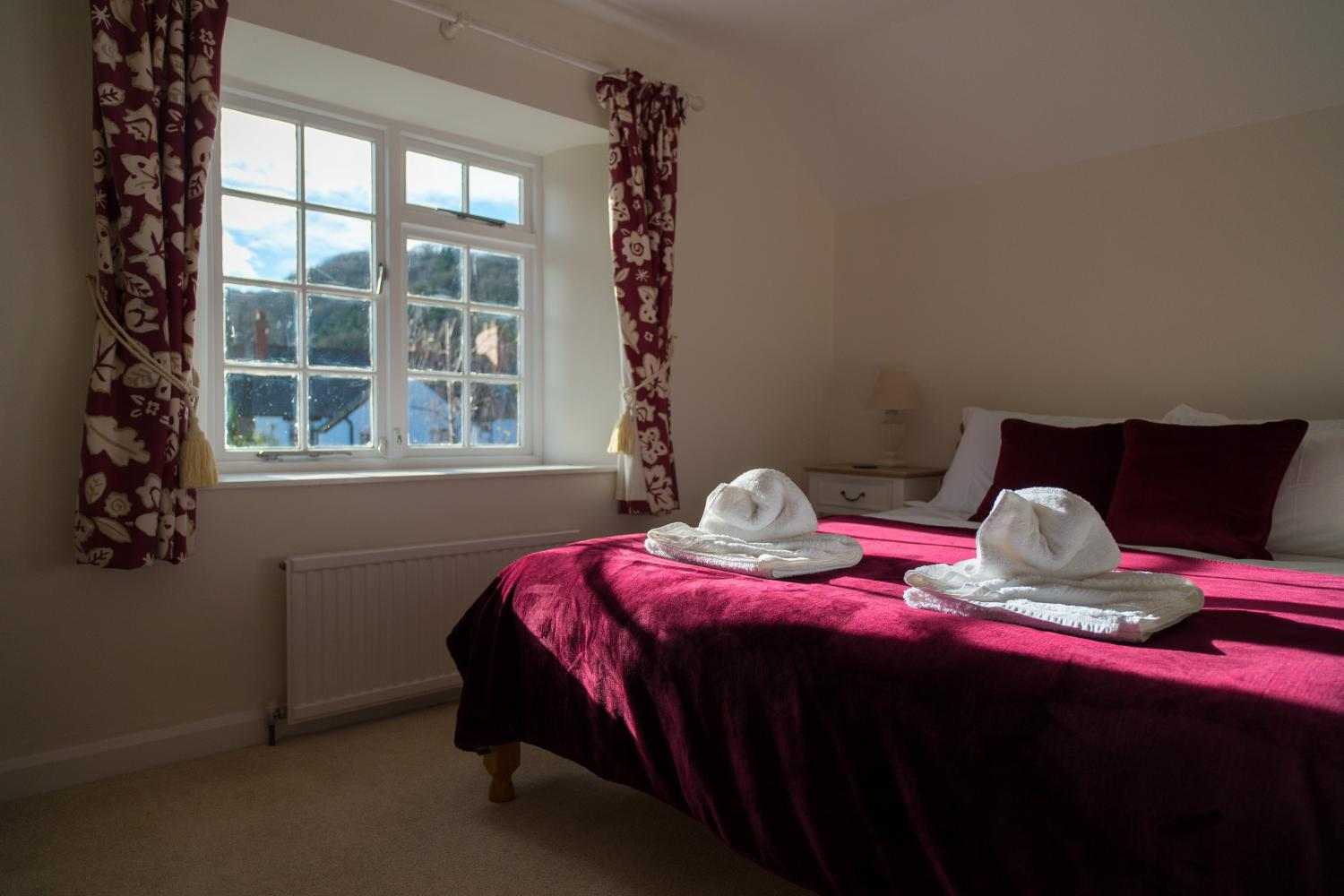 Bowness top floor bedroom with view of The Moors