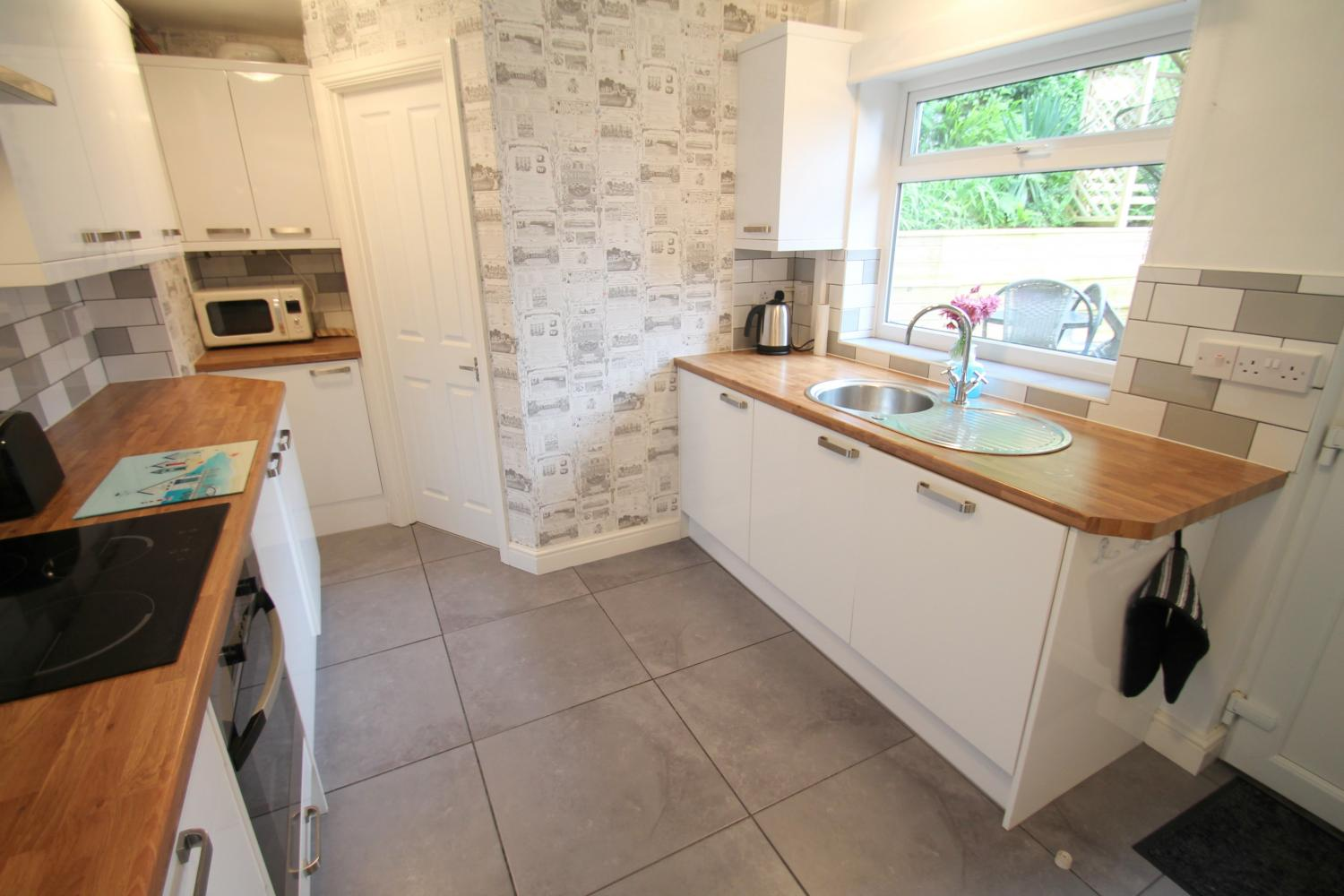 Fully Fitted kitchen opening to decked courtyard Detail
