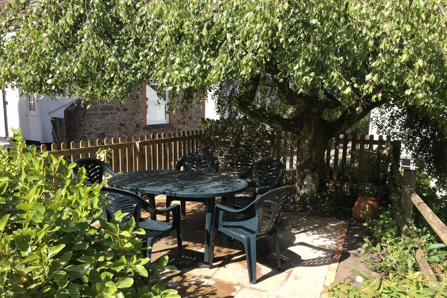 Sunny seating area opposite the cottage
