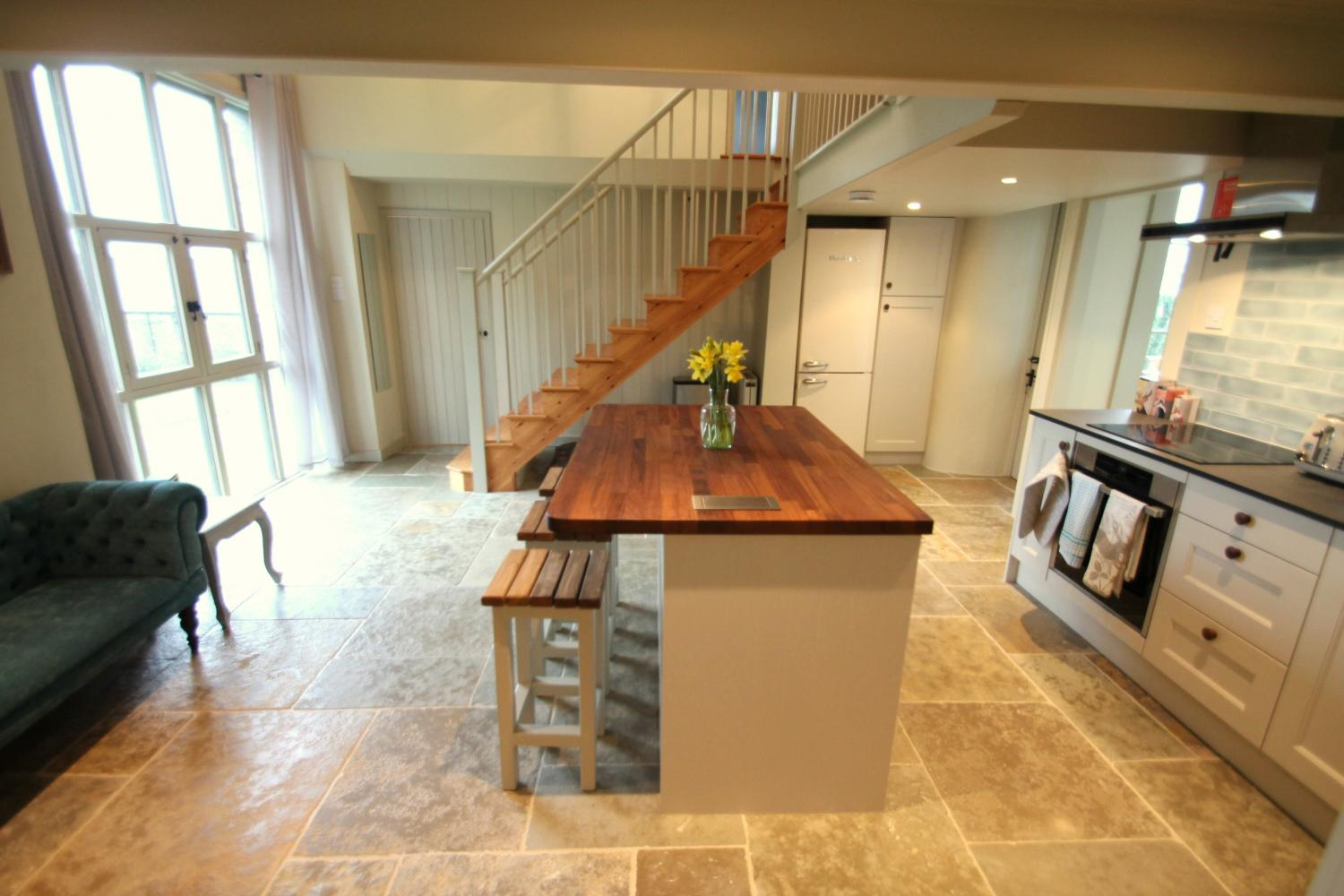 Airy kitchen with flagstone floor.
