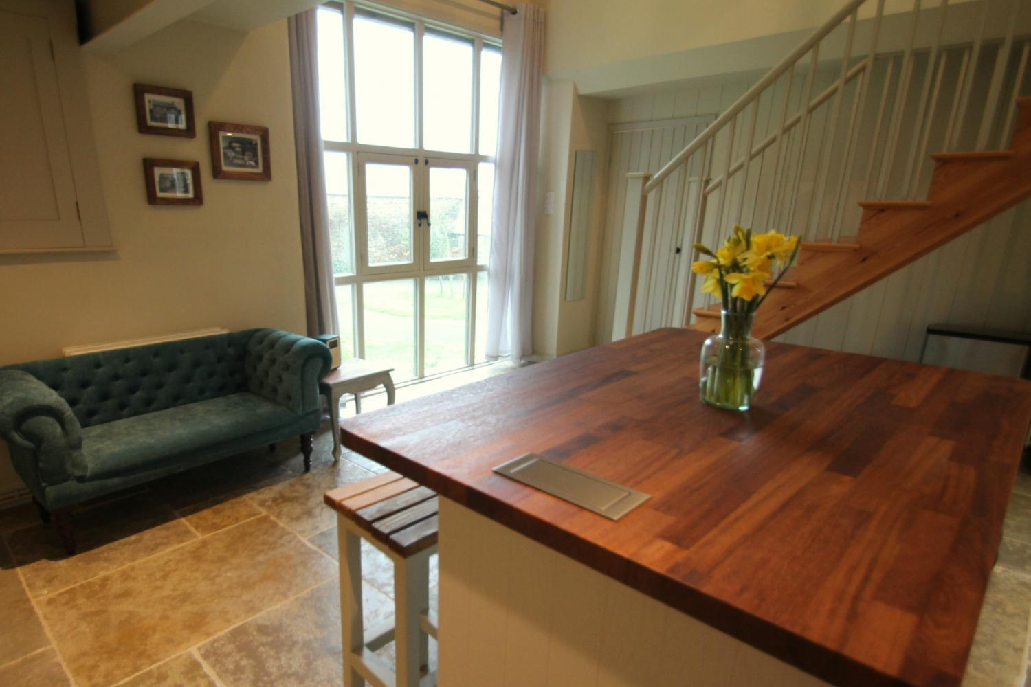 The huge window in the kitchen replaces the former barn doors, and looks out over the farm buildings.