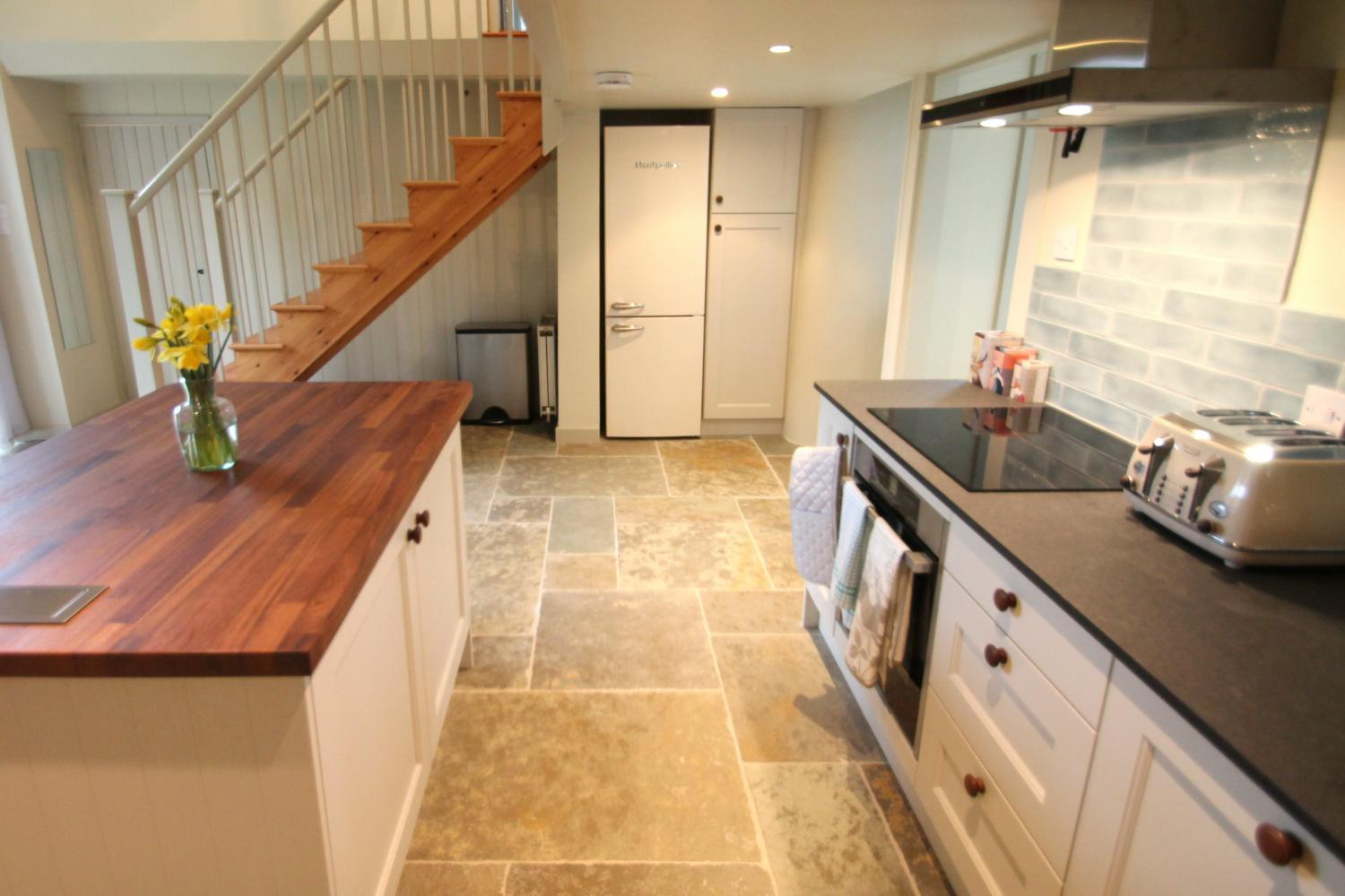 Wood and granite worktops, solid wood cupboards and brand new oven, hob and fridge freezer.