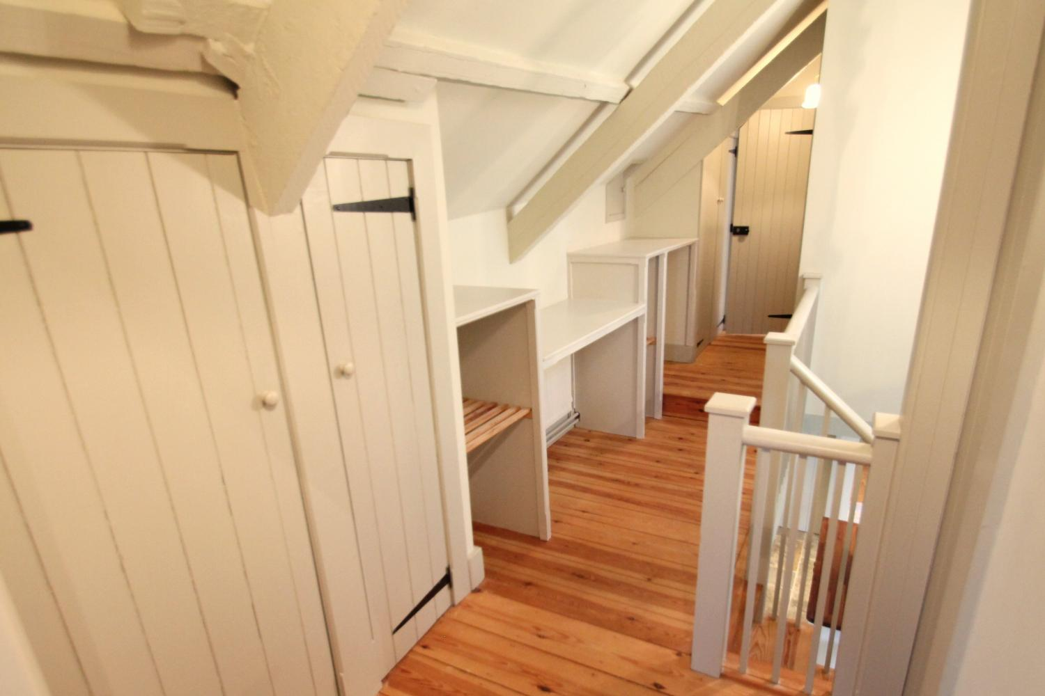 There is plenty of extra storage on the landing should you need it.