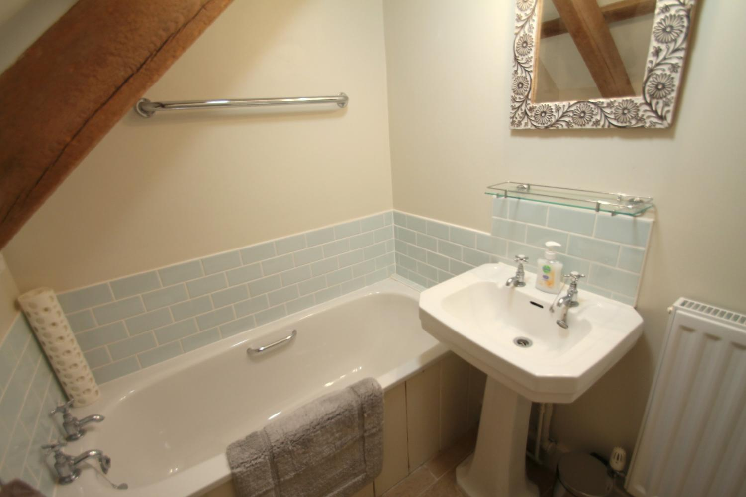 The small en-suite bathroom adjoining the double bedroom.