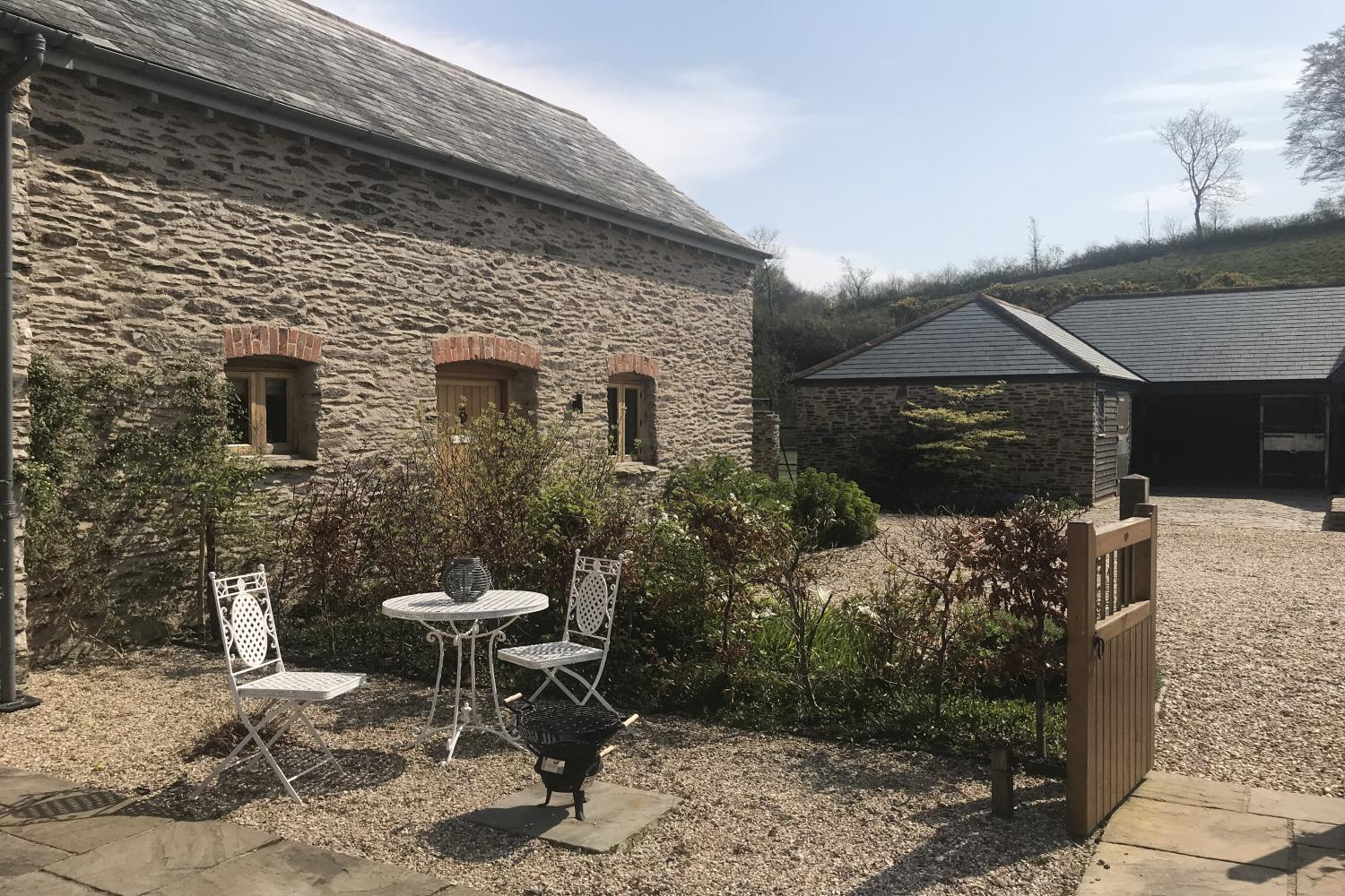 The Cowshed with patio table and chairs