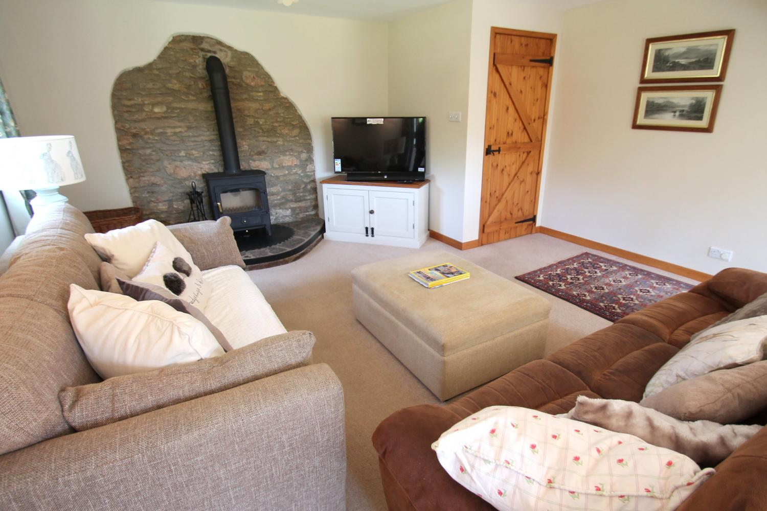 Middle Stolford living room with log burner