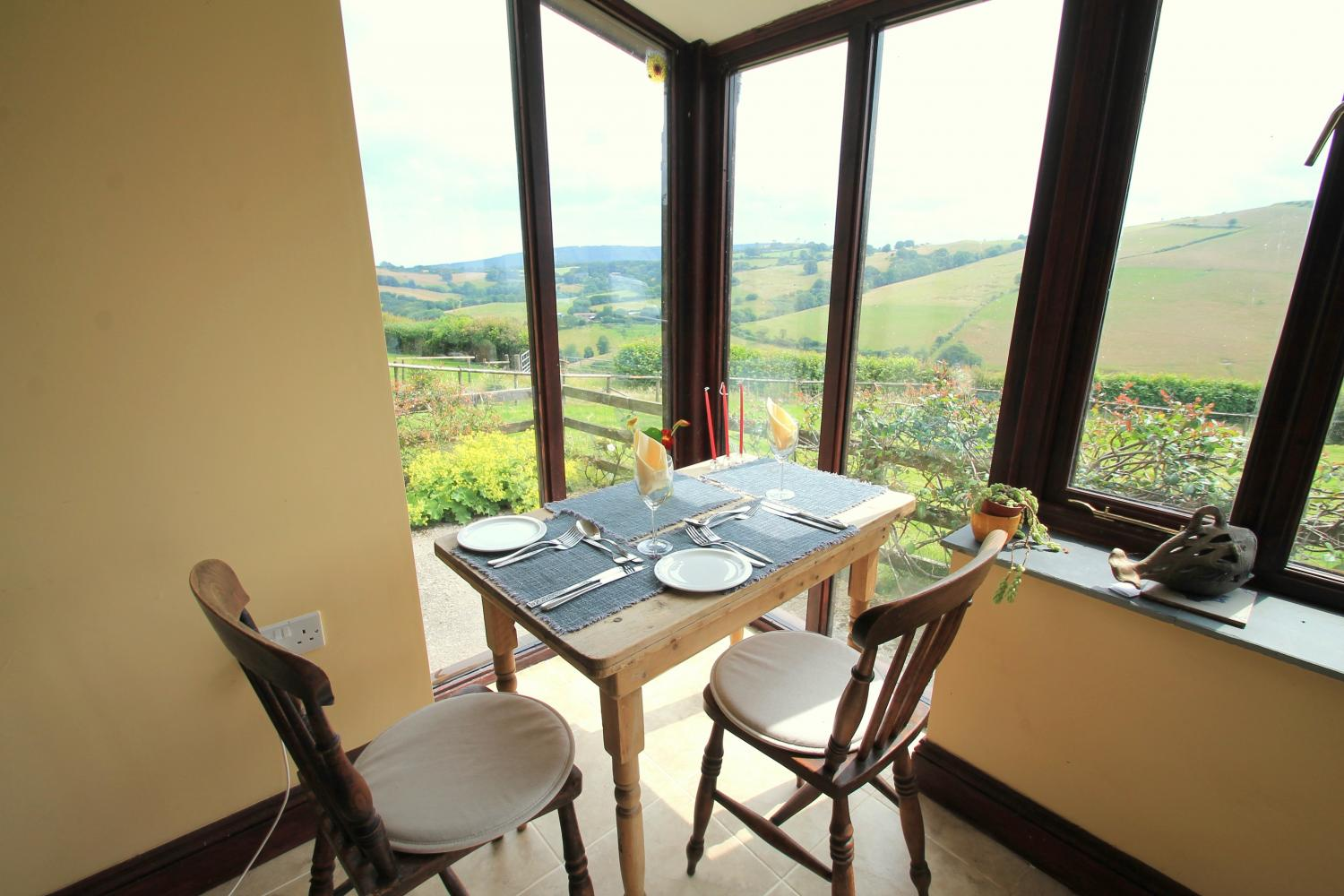 Dine in the conservatory at Higher Putham Barn